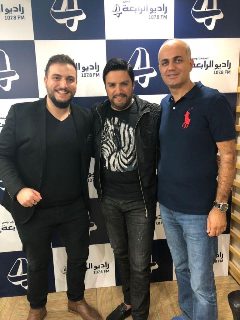 فيليب رياشي وجاد وهبي مع الفنان هشام الحاج