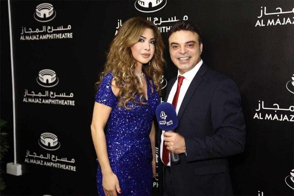 عمر مع النجمة الذهبية نوال الزغبي على مسرح المجاز في الشارقة
